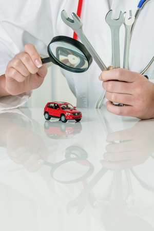 auto garage: car is checked by a doctor  costs for maintenance and repair