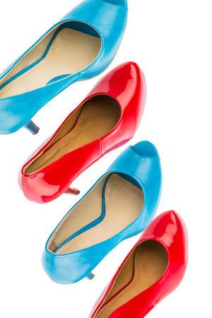 schoenen met hoge hakken te beschermen tegen een witte achtergrond Stockfoto
