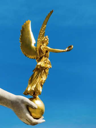 greek alphabet: statue of parliament government in vienna, austria
