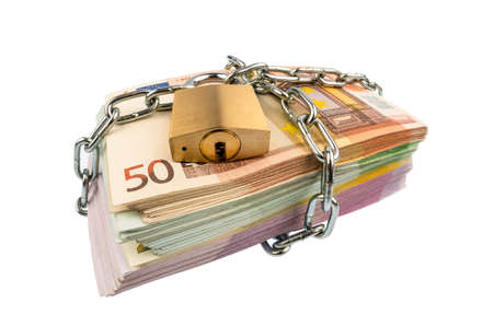 devaluation: euro banknotes with chain and padlock