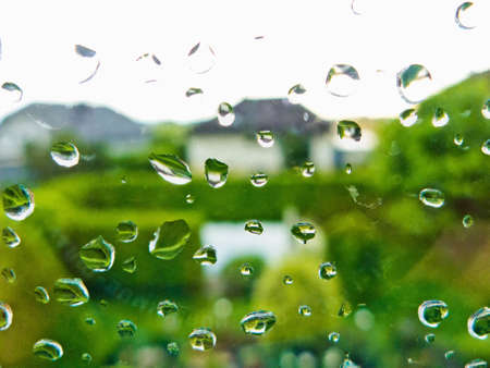 many raindrops in bad weather on a window pane  rainy weather Stock Photo - 20772582