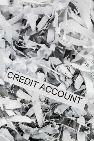 creditworthiness: shredded paper tagged with credit account Stock Photo