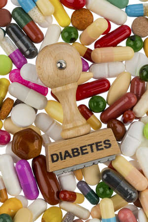 mellitus: stamp on colorful tablets with word diabetes