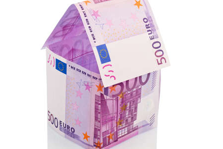 sponsors: a house built with money euro appear on a white background Stock Photo