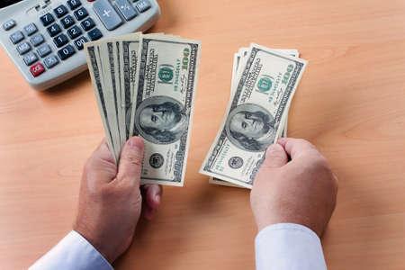 seem: dollar bills in hand