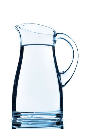 purely: a pitcher of water against white background Stock Photo