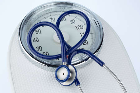 stethoscope and balance symbol photo for weight, diet and heart disease