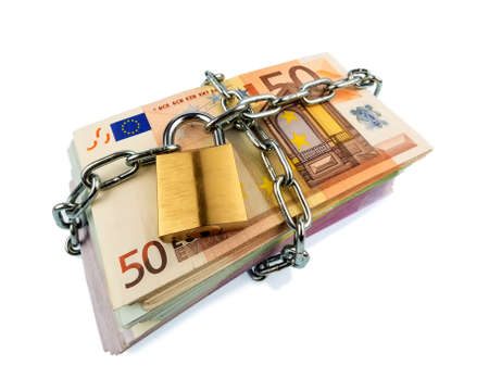 yield: euro banknotes with chain and padlock. photo icon for security and inflation. Stock Photo