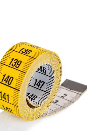cintas metricas: cinta m?trica amarilla, foto simb?lica para el control de la dieta y de precisi?n