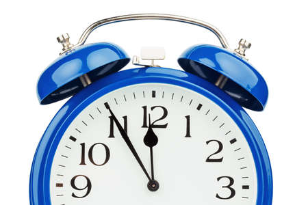 constraints: a blue alarm clock on a white background. five to twelve
