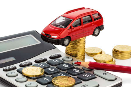 car and calculator. rising costs of car purchase, lease, workshop, refueling and insurance photo