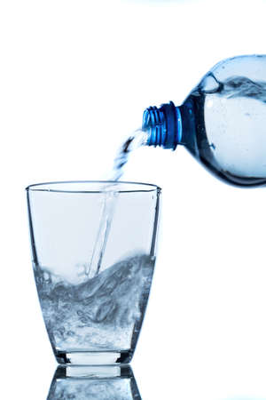 from a water bottle of water being poured into a glass Stock Photo - 22717476