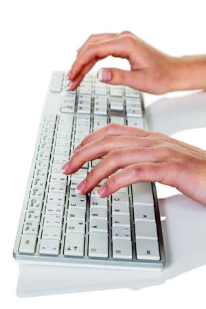 grope: a woman in an office working on a computer keyboard