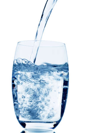 purely: water is poured into a glass, symbolic photo for drinking water, freshness, demand and consumption