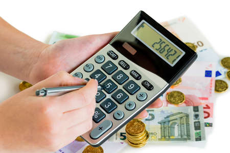 accounted for: hand with calculator and bills. symbolic photo for revenue, profit, taxes and costing
