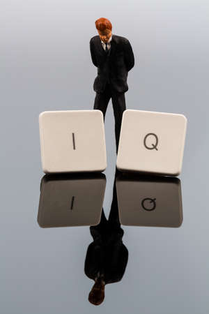 iq: the letters iq as a symbol photo for intelligence quotient.