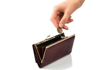 an empty purse and a hand holding a coin against white background