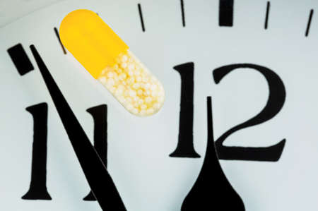 essentially: capsule on a clock, symbolic photo for healthcare, health reform, congestion