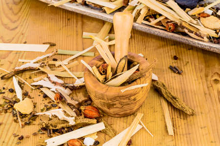 naturopaths: ingredients for a tea in traditional chinese medicine. healing of diseases through alternative methods. Stock Photo