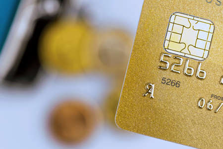 cashless: a gold credit card and an empty wallet. symbolic photo for cashless transactions and status symbols. Stock Photo