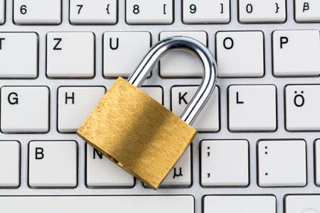 a padlock on a computer keyboard. symbolic photo for data security and hacking photo