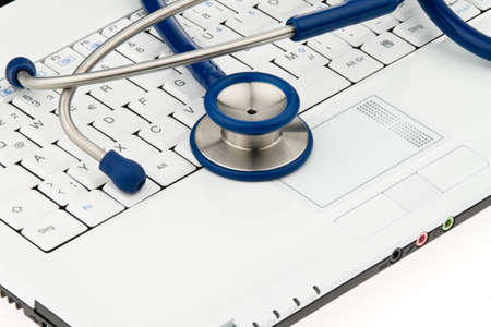 stethoskope: stethoscope on laptop computer. security for data on the internet Stock Photo