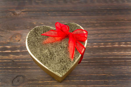 cordially: a box for a gift in the shape of a heart. photo icon for valentines day, wedding anniversary, engagement.