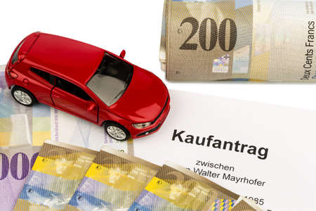 swiss franc: the purchase contract for a new car at a swiss car dealer. with swiss francs.