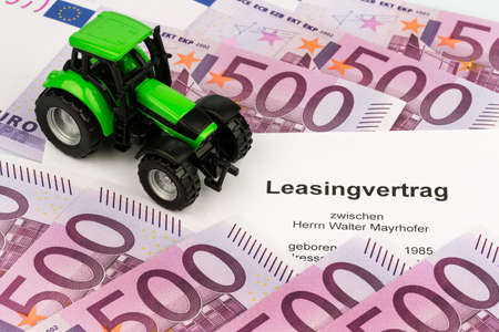 the lease agreement for a new tractor. with pen and euro money photo
