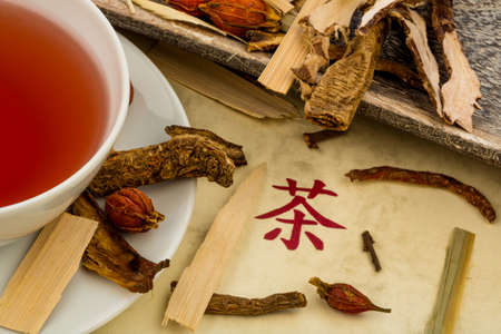 ingredients for a tea in traditional chinese medicine. healing of diseases through alternative methods. Stock Photo