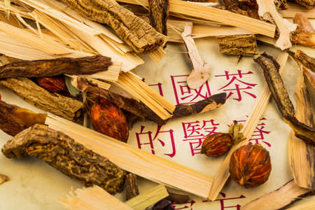 and traditional chinese medicine: ingredients for a tea in traditional chinese medicine. healing of diseases through alternative methods. Stock Photo