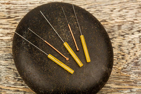 and traditional chinese medicine: several needle for acupuncture are adjacent. traditional chinese medicine (alternative medicine).