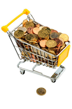 consumerist: a shopping cart is filled with euro coins. symbolic photo for purchasing power and consumption Stock Photo