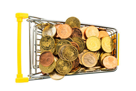 a shopping cart is filled with euro coins. symbolic photo for purchasing power and consumption photo
