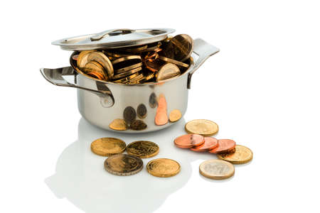 subsidize: a cooking pot is filled with euro coins, symbolic photo for grants and subsidies Stock Photo