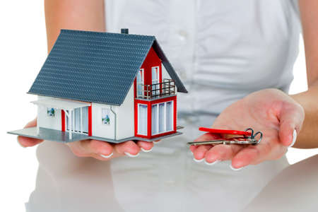 immobilien: a broker for real estate with a house and a key. successful leasing and property for sale by real estate agents.