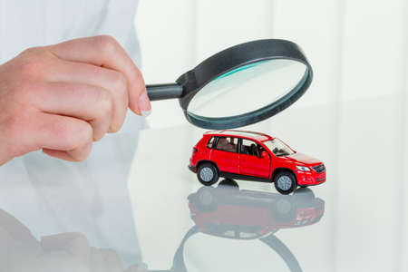 workshop service: a model of a car is examined by a doctor. photo icon for workshop, service and car buying. Stock Photo