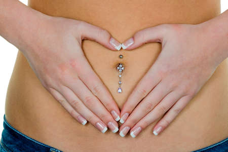 digestive disease: a woman has abdominal pain or stomach pain. hands in heart shape around navel piercing.