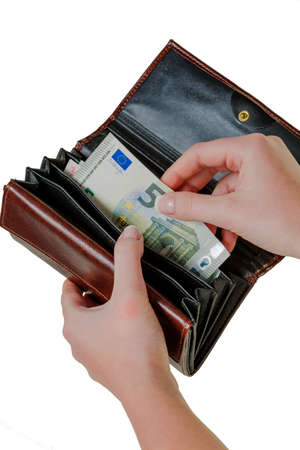 subsistence: in a wallet, there are some euro banknotes. money is scarce, the new poverty. Stock Photo