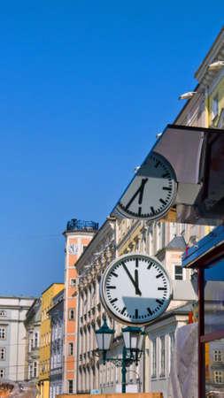 hauptplatz: austria, linzs main square. with clock 11:55 Stock Photo