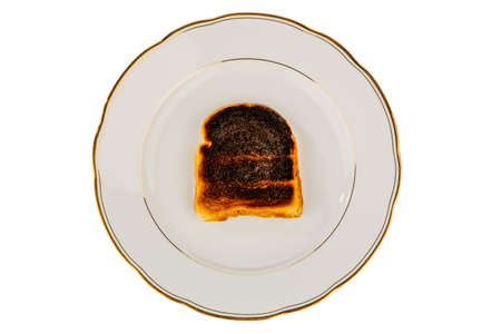 burnt toast: toast the toast was burnt. burnt toast at breakfast. Stock Photo