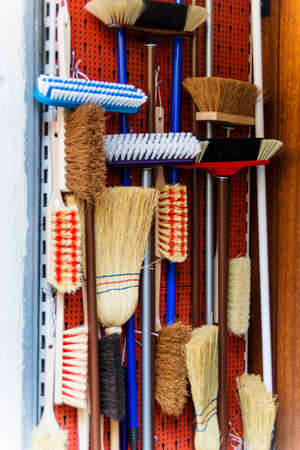putz: cabinet with different kinds of broom Stock Photo