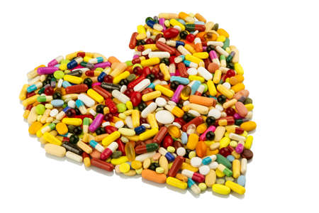 heart failure: colorful tablets arranged in heart shape, symbol photo for heart disease, medication and pharmaceuticals