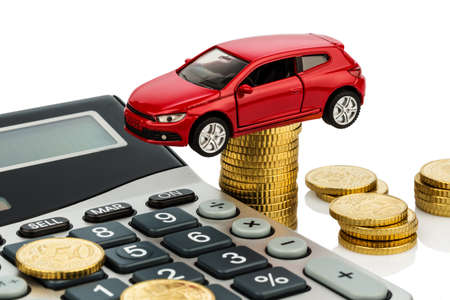 refuel: car and calculator. rising costs for car purchase, lease, workshop, refueling and insurance Stock Photo