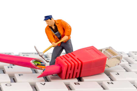 workers, network connector, keyboard, symbol photo for internet failure, maintenance, problem solving, Stock Photo