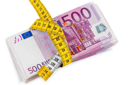 notes and tape measure, symbolic photo for austerity measures, fiscal consolidation and controlling Stock Photo - 24002464