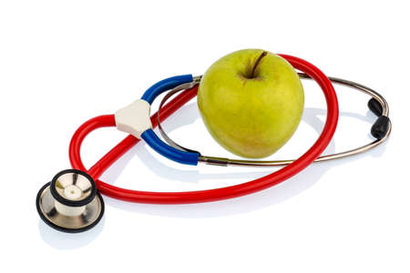 dietitian: an apple and a stethoscope on a doctor. symbolic photo for healthy and vitamin-rich diet.