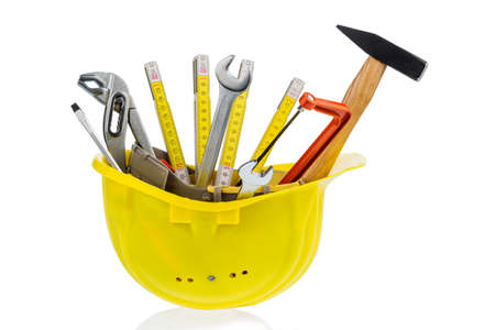 botch: hand tool in a protective helmet, icon photo for crafts, construction, home improvement Stock Photo