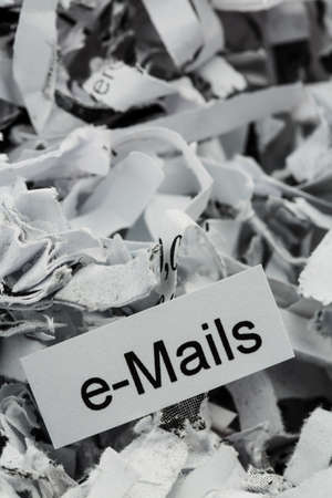 shredding: shredded paper tagged with e-mails, symbol photo for data destruction, mails and data flooding Stock Photo
