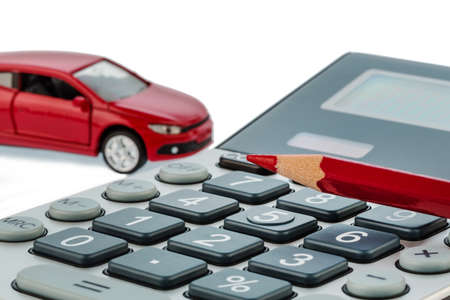 mileage: a car and a red pen is on a calculator. cost of gasoline, wear and insurance. car costs are not paid by commuter tax. Stock Photo
